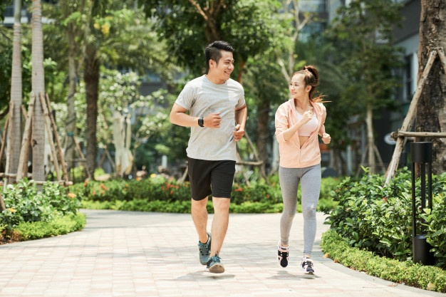 couple-jogging-in-park_1098-18124